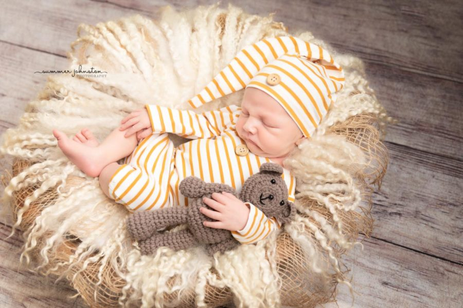 Baby boy asleep I a striped sleepy set