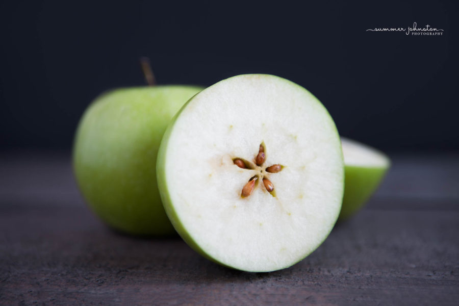 Apple cut in half to show start shape of seeds