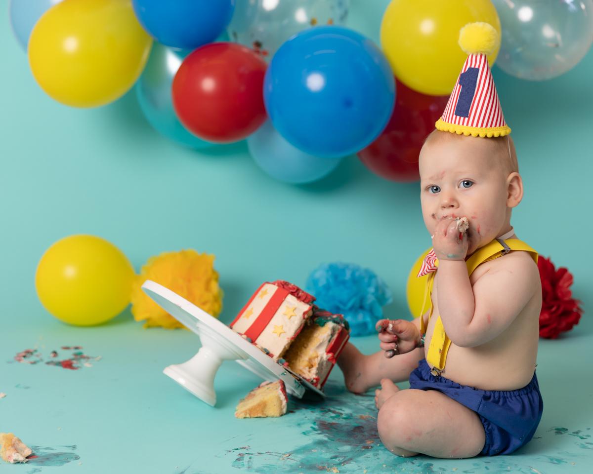 Little baby boy enjoying his cake smash shoot in my Rawtenstall studio
